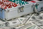 Suitcase of Cash and Poker Chips